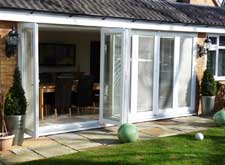 seven pane pvc folding sliding doors in white, oak, rosewood pvc