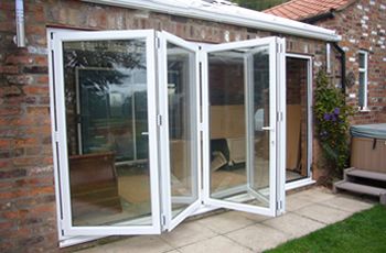 Aluminium white folding sliding stock bifold door, 14 ft, foot, four ...
